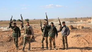 Syrian government troops celebrate after freeing soldiers from airbase siege