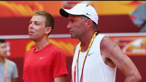 Galen Rupp of the United States (L) and coach Alberto Salazar