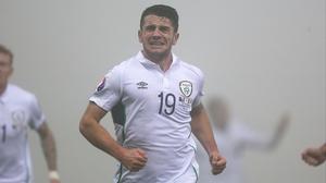 Goal-scorer Robbie Brady reacts to his strike against Bosnia-Herzegovina