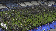Spectators poured onto the pitch after explosions were heard near the Stade de France