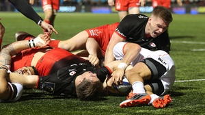 Chris Wyles of Saracens stretches backwards to score his second try