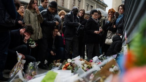 Crowds gather outside Le Petit Cambodge in Paris