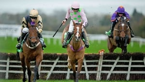 David Mullins on Nichols Canyon clears the last ahead of Ruby Walsh on Faugheen and Paddy Mullins on Wicklow Brave