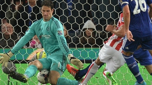 Jon Walters, playing for Stoke City, has his effort blocked by Chelsea's Asmir Begovic