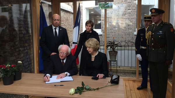 President Michael D Higgins and his wife Sabina signed a book of condolences