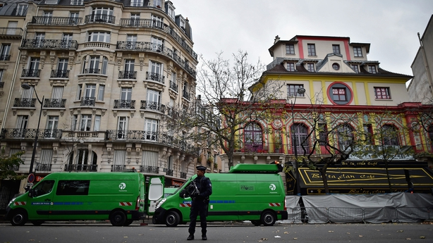 A French police officer stands at the entrance to the Bataclan concert hall