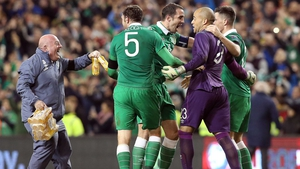 The Ireland defence and kit man Dick Redmond are overjoyed at full-time