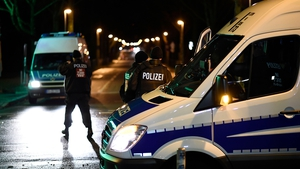 Police forces secure a scene at the HDI-Arena in Hanover, Germany