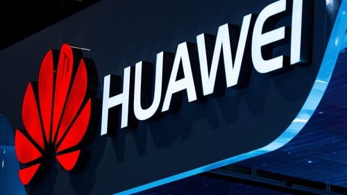 Huawei will boost production while also reducing layers of management as it tries to counter the impact of US measures