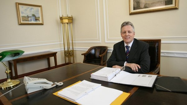 Peter Robinson sits at the First Minister's desk for the first time in 2008