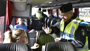 A police officer checks the papers of a train passenger travelling from Denmark at Lernacken on the Swedish side of the Oresund strait