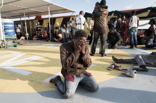 Moussa, 15, from Ivory Coast, cries on the deck of MSF boat Bourbon Argos after being rescued this summer. Credit: Christophe Stramba-Badi
