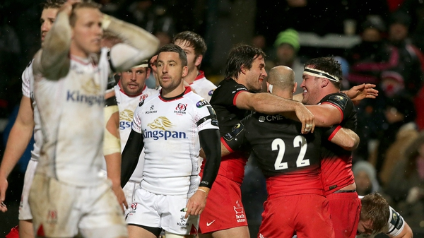 Saracens' players celebrate their last try of the night