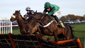 Irving (left) and Top Notch clear the last in the Betfair Price Rush Hurdle at Haydock