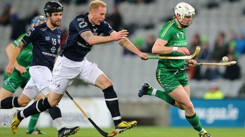 Ireland's Damien Healy is tackled by Conor Cormack of Scotland