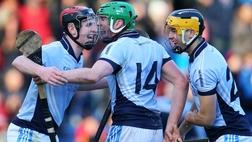 David Dempsey, Shane Dowling and Tommy Grimes of Na Piarsaigh celebrate after the final whistle