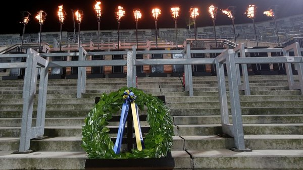 A wreath lies in front of 14 torches on Hill 16 to remember the 95th anniversary of Bloody Sunday