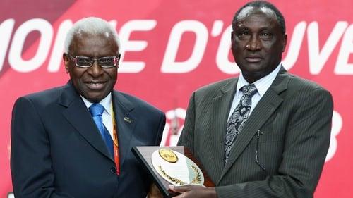 Former IAAF president Lamime Diack (L) with Isaiah Kiplagat of Kenya