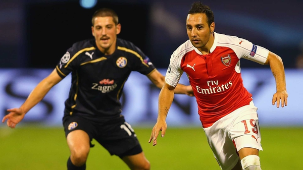 Santi Cazorla (R) goes past Arijan Ademi of Dinamo Zagreb, who was handed a four-year ban for failing a drugs test after the Croatian side beat Arsenal in September.