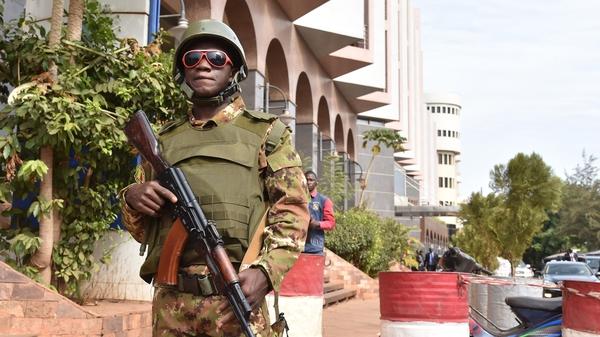 A Malian soldier outside the Radisson Blu hotel in Bamako