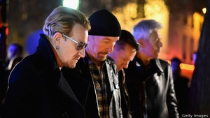 U2 pay their respects at the Bataclan in Paris
