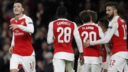 Arsenal's Mesut Ozil (L) celebrates the opener