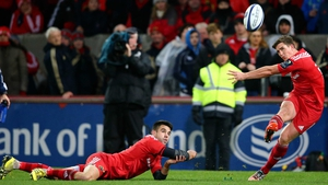 Ian Keatley kicks a conversion with help from Conor Murray