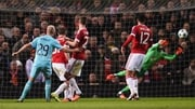 David De Gea of Manchester United makes a save from Jorrit Hendrix