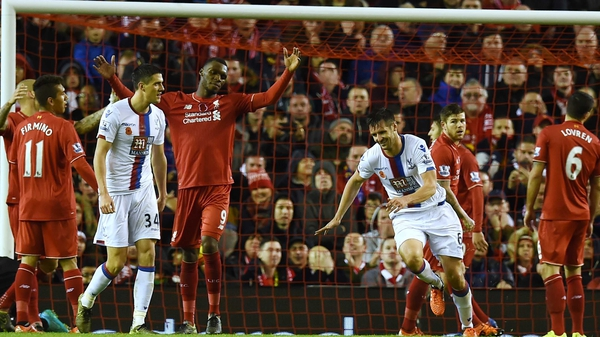 Scott Dann wheels away in celebration after scoring in Crystal Palace's 2-1 win at Anfield