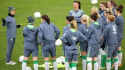 Irish manager Sue Ronan speaks to her players during training
