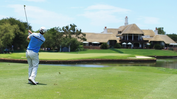 Christiaan Basson hits his approach to the 18th green