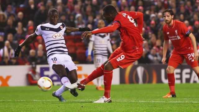 Benteke fires Liverpool into Europa knockout stage