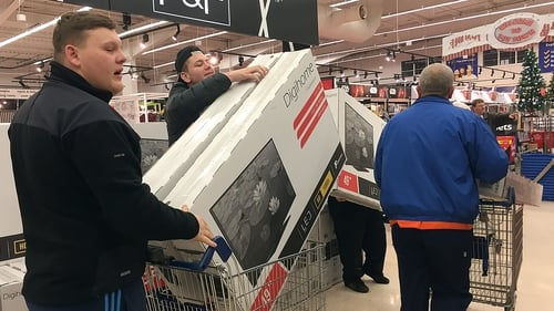 Early morning shoppers in the UK were seen loading up their trollies with high-value items including TVs