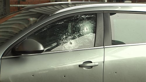 The bullet-proof glass and reinforced panelling on the PSNI car protected the two officers sitting inside