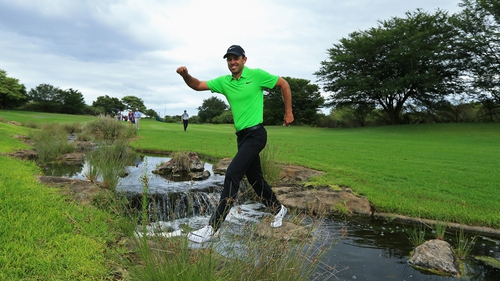 Charl Schwartzel crosses a water hazard at the Alfred Dunhill Championship in South Africa