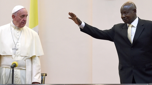 Pope Francis is welcomed by Uganda's president Yoweri Museveni at his arrival in Entebbe, Uganda