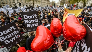 'Peace' balloons float up amongst 'Don't bomb Syria signs' outside Downing Street