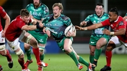 Jack O'Donoghue and Francis Saili of Munster tackle Connacht's Kieran Marmion