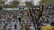 Activists laid out more than 20,000 pairs of shoes in the Place de la Republique in Paris to symbolise absent marchers