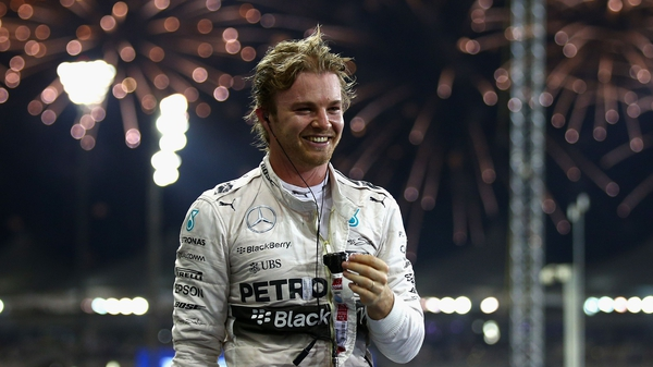 Nico Rosberg of Germany and Mercedes GP celebrates in Parc Ferme after winning the Abu Dhabi Formula One Grand Prix