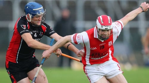 Cuala's Con O'Callaghan and Barry Kehoe of Oulart The Ballagh battle for possession