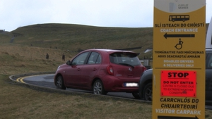 Walkers ignore advice to stay away from the Cliffs of Moher in Co Clare
