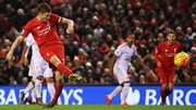 James Milner lifts his penalty high into the Swansea net to put Liverpool ahead