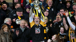 Paul Hearty lifts the cup for Crossmaglen