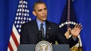 US President Barack Obama speaking at a climate change press conference in Paris