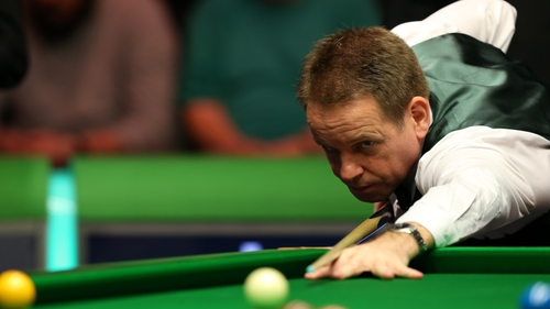 Joe Swail in action against Martin Gould