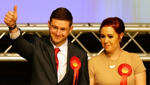 Labour candidate Jim McMahon with his partner Charlene celebrates victory