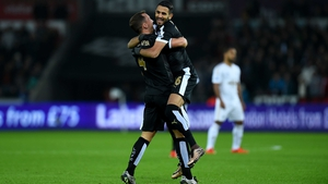 Riyad Mahrez celebrates after scoring his first goal with Danny Drinkwater (L)