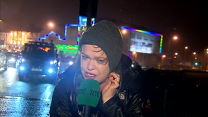 Teresa Mannion braving the elements and cheering up the nation last December