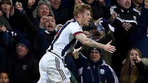 James McClean celebrates his eualising goal against Tottenham